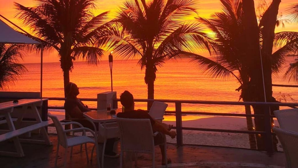 beautiful sunset on the patio of the beach bar in barbados