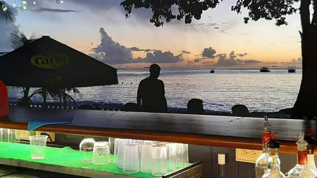 Behind the beach bar at sunset in barbados