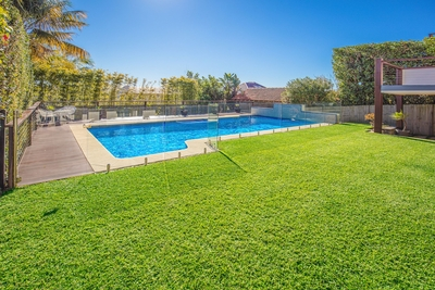 the landscaped garden with shimmering pool