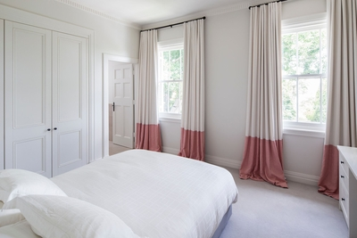 Spacious second bedroom with queen bed and ensuite