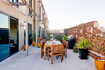 beautiful terrace with dining table and BBQ
