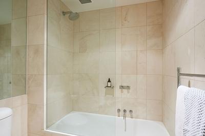 stylish bathroom with shower over bath