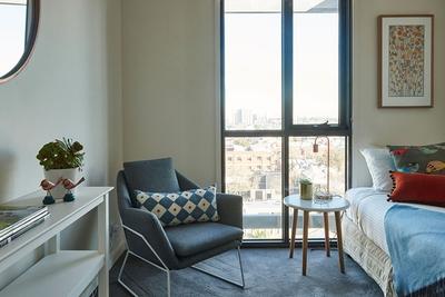 tastefully furnished bedroom with single bed