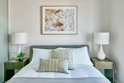 stylish bedroom with queen bed