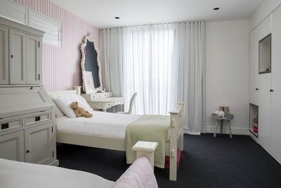 this lovely bedroom with two King single beds