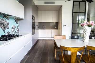 the gorgeous feature wall and white cabinetry