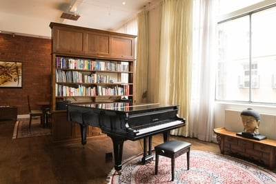 the entertainment zone with a grand piano